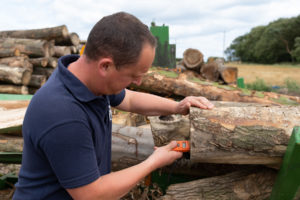 Testing the logs for moisture content